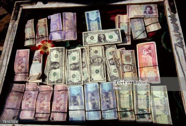 These banknotes hang behind the window next to the border passage of Landi Koral on July 2004 in Landi Koral Pakistan