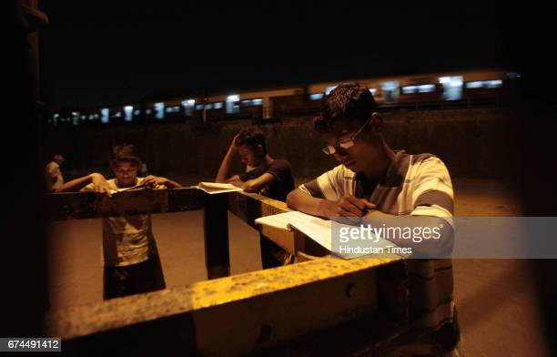 These Class 12 students of Lala Lajpat Rai College are forced to stand and study under this streetlight near the railway tracks