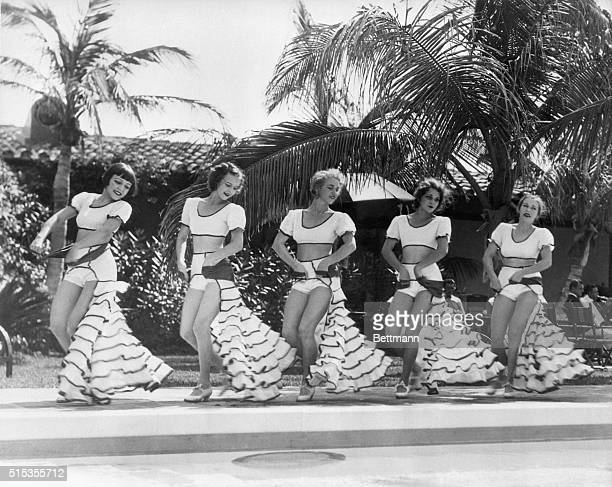 These five pretty dancers are giving a demonstration of the popular dance of the tropics the Rumba at the Nautilus Bath Club Members of the gay...