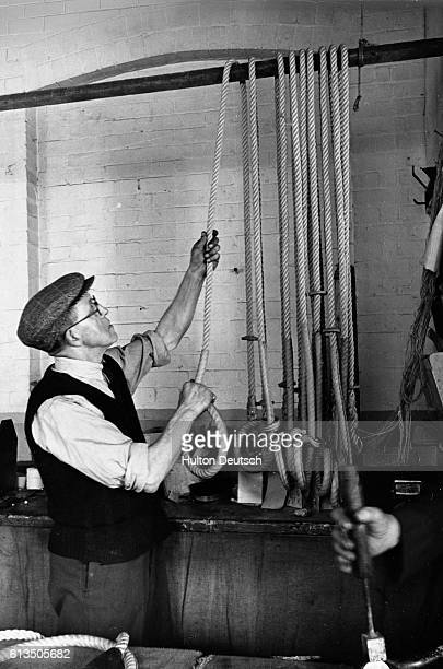 These hangman's ropes were made by John Edgington of Old Kent Road London Edgington's assistant tests the ropes for smooth running which depends on...