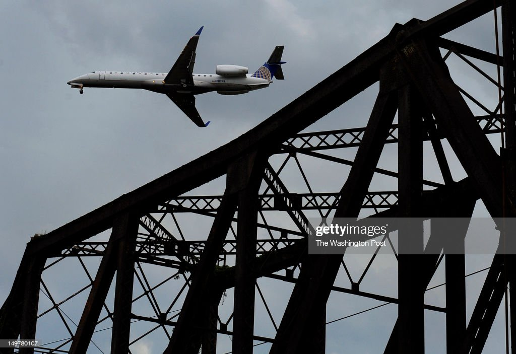 These photos of passenger jets on approach (and landing) at Reagan National Airport were taken just hours after a near collision. The near disaster occurred at about 2:00pm and these images were made later in the afternoon from a boat on the Potomac River. There were thunder heads in the area in the late afternoon and early evening and many of the incoming planes made adjustments on approach because of storm clouds nearby. (Photo by Michael S. Williamson/The Washington Post via Getty Images
