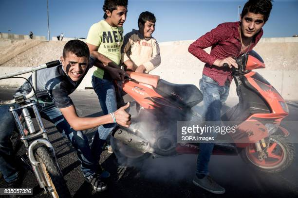 These Syrian boys showing off and literally burning rubber during the weekends where the unfinished highway from Beirut to Damascus becomes a safe...