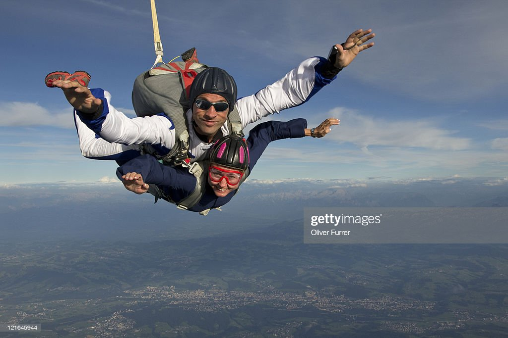 These tandem skydivers are having fun in freefall
