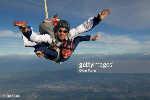 These tandem skydivers are having fun in freefall : Stock Photo