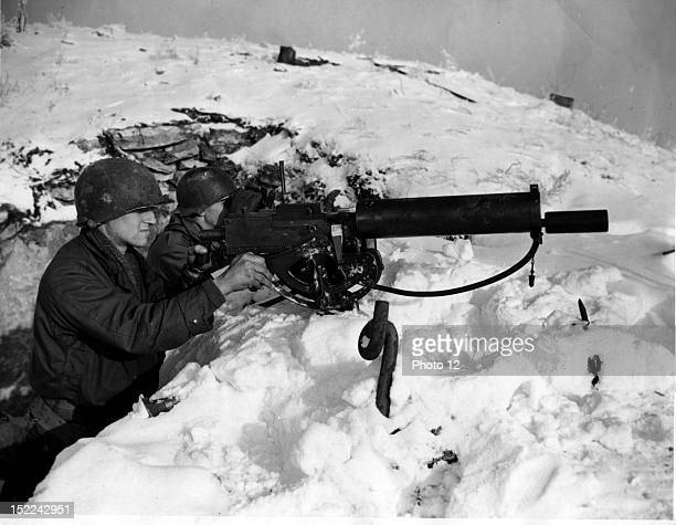 These two machinegunners are members of the 397th US Inf Regt 100th Inf Div in Aachen area January 12 1945