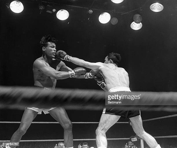 These unusual camera angle shots of last night's fight in Chicago Stadium in which Sugar Ray Robinson emerged Champion in the MiddleWeight division...