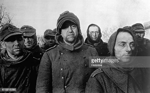 These wearylooking German soldiers members of the Volkssturm or 'People's Army' battalions are shown en route to a prisoner of war camp after their...