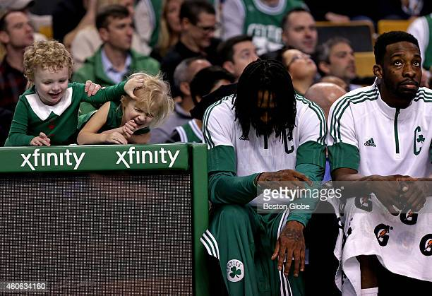 These young Celtics fans and Boston Celtics forward Gerald Wallace and Boston Celtics forward Jeff Green watched as the time wound down late in the...