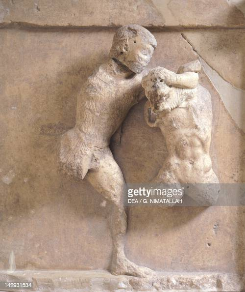 Theseus and the Minotaur high relief from the metope of the Treasury of the Athenians in Delphi Greece Greek civilization 5th Century BC Delphi Museum
