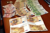 Confiscated fake euro banknotes are on display at the police headquarters in the northern Greek city of Thessaloniki 30 March 2006 after a teenage...