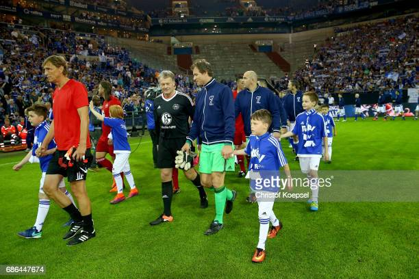 Theteams enter the pitch prior to the 20 years of Eurofighter match between Eurofighter and Friends and Euro All Stars at Veltins Arena on May 21...