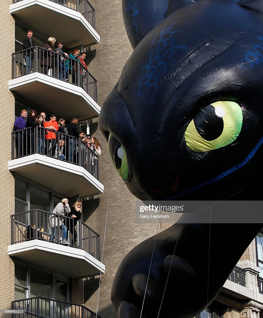 TheToothless balloon floats down Central Park West in the Macy's Thanksgiving Day Parade in New York November 26 2015