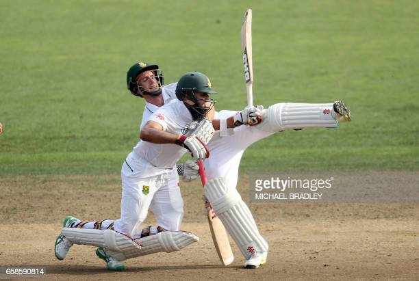 TOPSHOT Theunis de Bruyn is run out after he and Hashim Amla of South Africa run into each other during day four of the third Test cricket match...