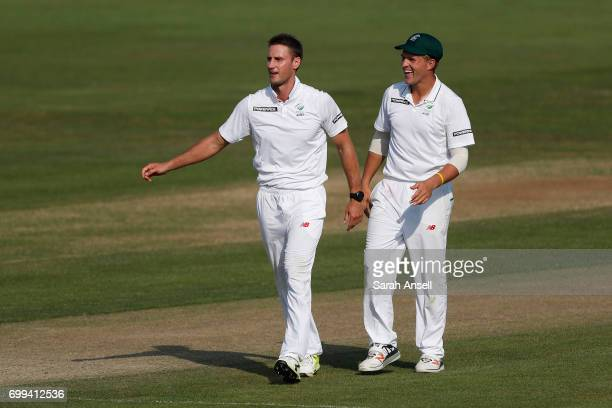 Theunis de Bruyn of South Africa A celebrates with teammate Willem Mulder after taking the wicket of Sam Curran of the England Lions during day 1 of...