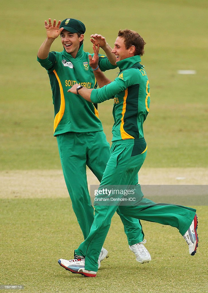 Theunis de Bruyn of South Africa (R) celebrates with team mate Chad Bowes after taking the wicket of Naeem Islam jr of Bangladesh during the ICC U19 Cricket World Cup 2012 match between South Africa and Bangladesh at Allan Border Field on August 12, 2012 in Brisbane, Australia.