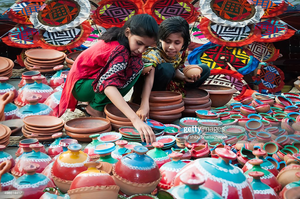 They busy in choose various colors soil made toys