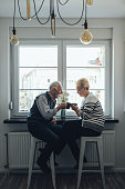Elderly couple having coffee