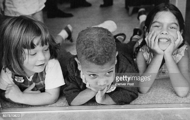 They waited while their parents held a sitin Sunday at Morbro homes in Aurora From left are Kim Schweizer 3 Frederick Hawkins and Karin...