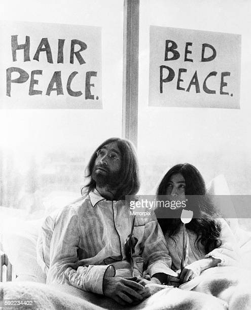They will stay in bed for seven days with fruit flowers and peace signs March 1969 Z02902008