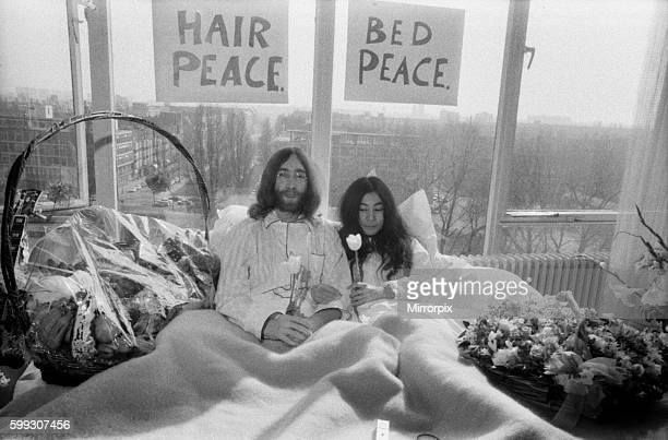 They will stay in bed for seven days with fruit flowers and peace signs March 1969 Z02902017