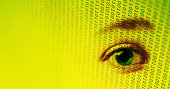 Eye on binary code. Could signify 'big brother', privacy, or retinal scanning