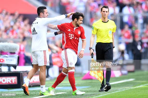Thiago Alcantara and Juan Bernat of FC Bayern Muenchen celebrate the opening goal during the Bundesliga match between Bayern Muenchen and SV...