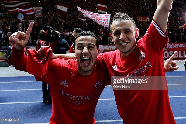 Thiago Alcantara and Rafinha of Munich celebrates after the Bundesliga match between and Hertha BSC and FC Bayern Muenchen at Olympiastadion on March...