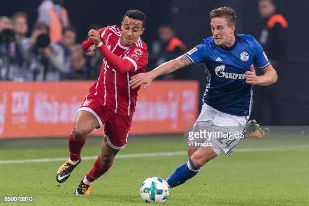 Thiago Alcantara do Nascimento of FC Bayern Munich Bastian Oczipka of FC Schalke 04 during the Bundesliga match between Schalke 04 and Bayern Munich...