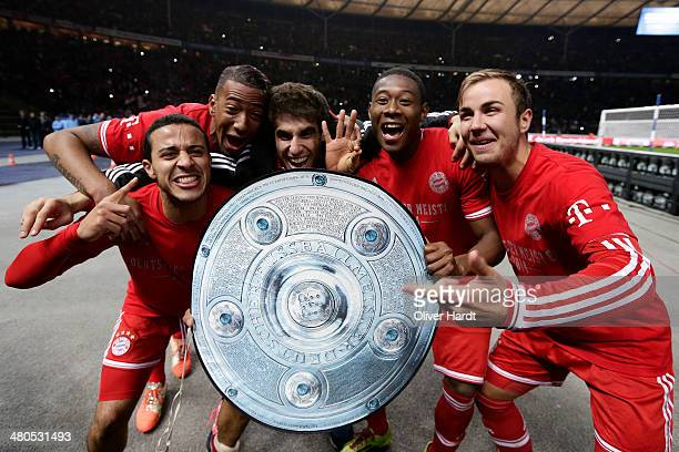 Thiago Alcantara Jerome Boateng Javi Martinez David Alaba and Mario Goetze of Munich celebrates after the Bundesliga match between and Hertha BSC and...