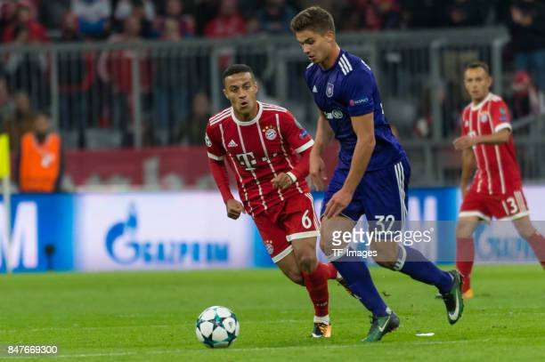 Thiago Alcantara of Bayern Muenchen and Leander Dendoncker of RSC Anderlecht battle for the ball during the UEFA Champions League group B match...