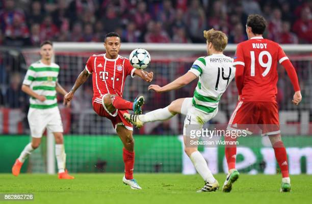 Thiago Alcantara of Bayern Muenchen and Stuart Armstrong of Celtic battle for posession during the UEFA Champions League group B match between Bayern...