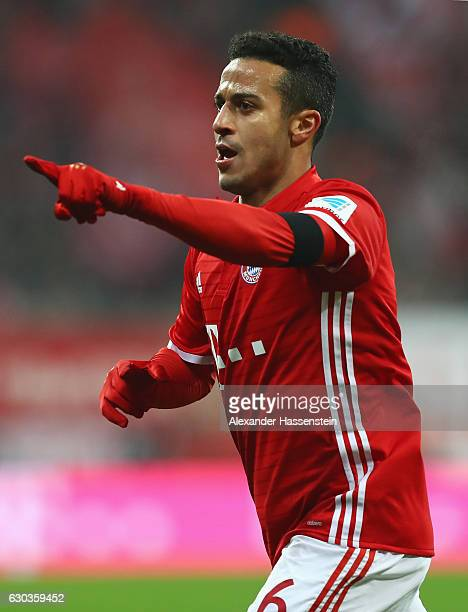 Thiago Alcantara of Bayern Muenchen celebrates scoring his sides first goal during the Bundesliga match between Bayern Muenchen and RB Leipzig at...