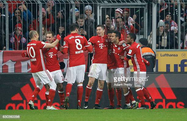 Thiago Alcantara of Bayern Muenchen celebrates scoring his sides first goal with his Bayern Muenchen team mates during the Bundesliga match between...