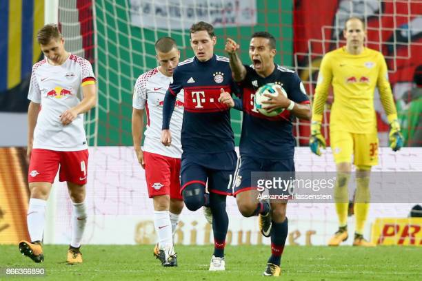 Thiago Alcantara of Bayern Muenchen celebrates scoring the first team goal during the DFB Cup round 2 match between RB Leipzig and Bayern Muenchen at...