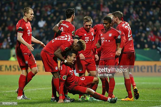 Thiago Alcantara of Bayern Muenchen celebrates with his team mates after scoring his side's second goal during the DFB Cup quarter final match...