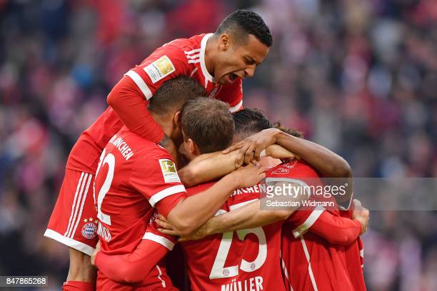 Thiago Alcantara of Bayern Muenchen celebrates with team makes after Robert Lewandowski of Bayern Muenchen scored his teams third goal to make it 30...