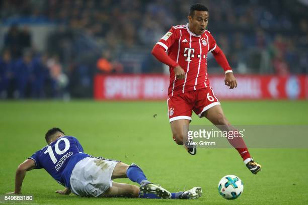 Thiago Alcantara of Bayern Muenchen fights for the ball with Nabil Bentaleb of Schalke during the Bundesliga match between FC Schalke 04 and FC...