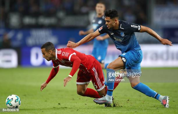 Thiago Alcantara of Bayern Muenchen fights for the ball with Nadiem Amiri of Hoffenheim during the Bundesliga match between TSG 1899 Hoffenheim and...