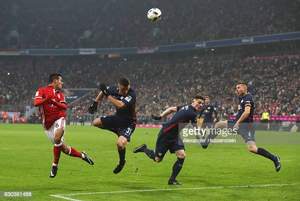 Thiago Alcantara of Bayern Muenchen heads the ball during the Bundesliga match between Bayern Muenchen and RB Leipzig at Allianz Arena on December 21...