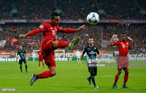 Thiago Alcantara of Bayern Muenchen jumps to control the ball during the UEFA Champions League Group F match between FC Bayern Muenchen and Arsenal...