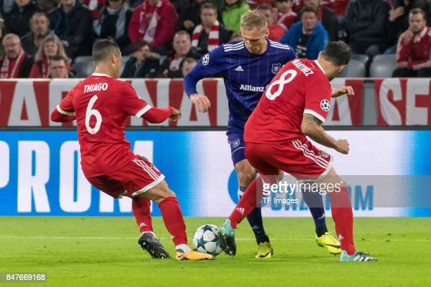 Thiago Alcantara of Bayern Muenchen Lukasz Teodorczyk of RSC Anderlecht and Javi Martinez of Bayern Muenchen battle for the ball during the UEFA...