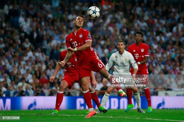 Thiago Alcantara of Bayern Muenchen saves on a header during the UEFA Champions League Quarter Final second leg match between Real Madrid CF and FC...