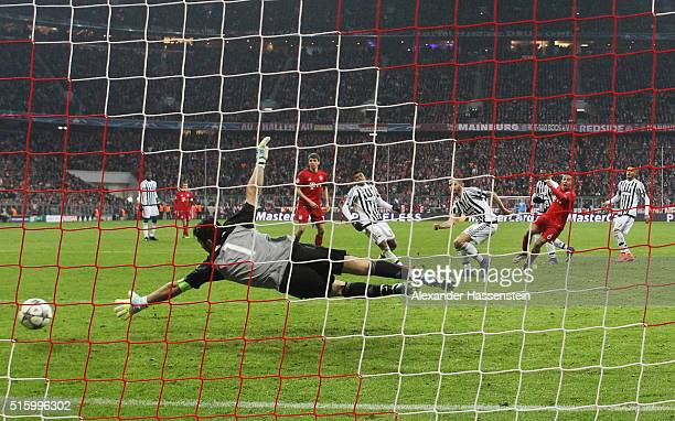 Thiago Alcantara of Bayern Muenchen scores his team's third goal past Gianluigi Buffon of Juventus during the UEFA Champions League round of 16...