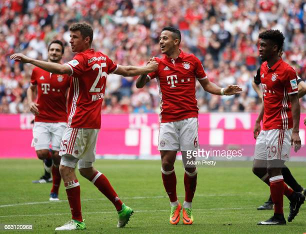 Thiago Alcantara of Bayern Munich celebrates after scoring the fourth goal during the Bundesliga match between Bayern Muenchen and FC Augsburg at...