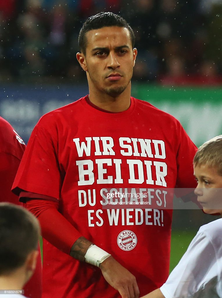 Thiago Alcantara of Bayern Munich wears a t-shirt showing support for injured team mate Holger Badstuber prior the Bundesliga match between FC Augsburg and FC Bayern Muenchen at SGL Arena on February 14, 2016 in Augsburg, Germany.