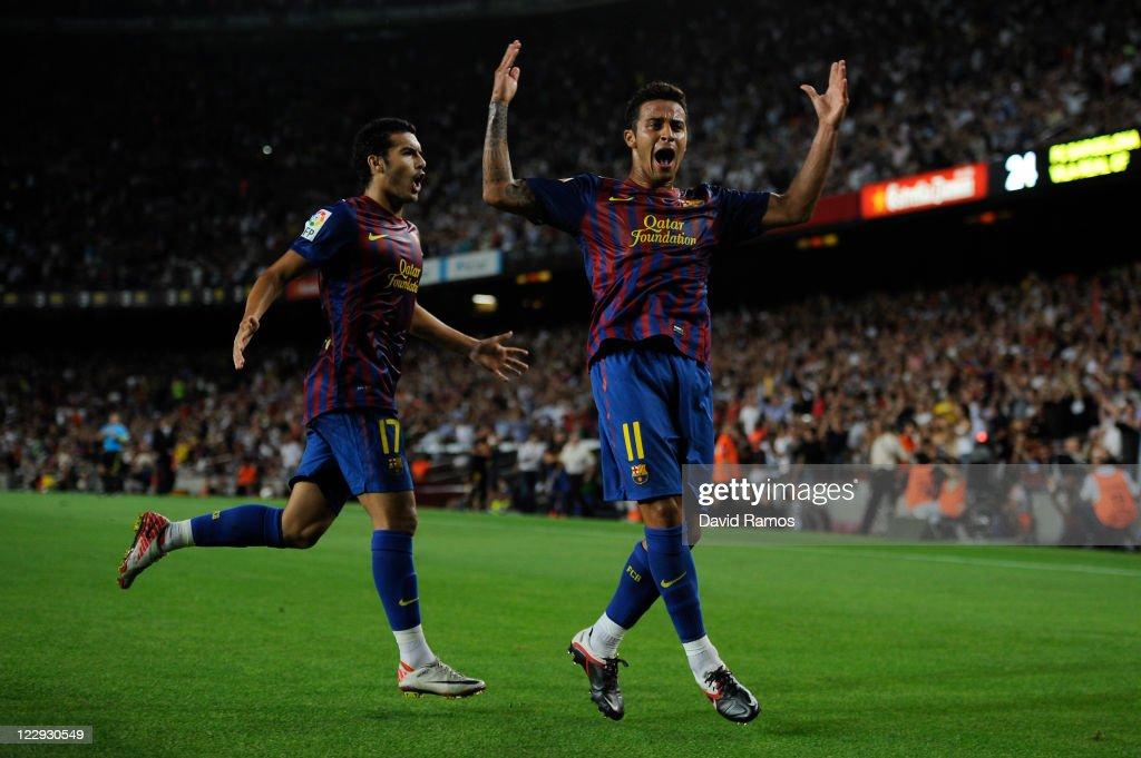 Thiago Alcantara of FC Barcelona (R) celebrates with his teammate Pedro Rodriguez of FC Barcelona after scoring his first team's goal during the La Liga match between FC Barcelona and Villarreal CF at Camp Nou on August 29, 2011 in Barcelona, Spain.