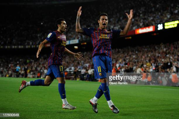 Thiago Alcantara of FC Barcelona celebrates with his teammate Pedro Rodriguez of FC Barcelona after scoring his first team's goal during the La Liga...