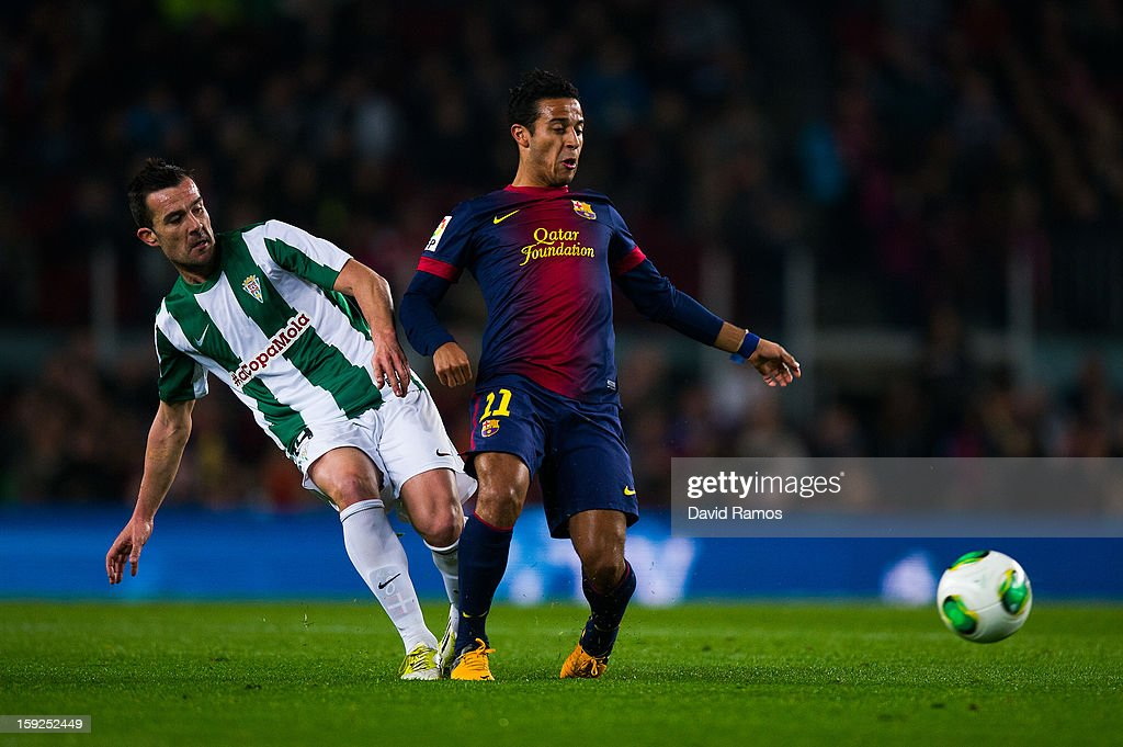 Thiago Alcantara of FC Barcelona (R) duels for the ball with Artiz Lopez Garai of Cordoba CF during the Copa del Rey round of sixteen second leg match between FC Barcelona and Cordoba CF at Camp Nou on January 10, 2013 in Barcelona, Spain.