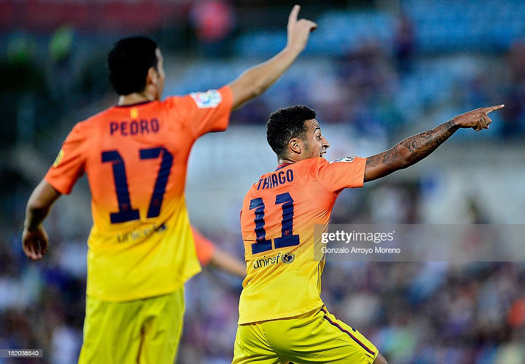 Thiago Alcantara of FC Barcelona reacts with his teammate <a gi-track='captionPersonalityLinkClicked' href=/galleries/search?phrase=Pedro+Rodriguez+Ledesma+-+Soccer+Player&family=editorial&specificpeople=5858048 ng-click='$event.stopPropagation()'>Pedro Rodriguez Ledesma</a> during the La Liga match between Getafe CF and FC Barcelona at Coliseum Alfonso Perez on September 15, 2012 in Getafe, Spain.