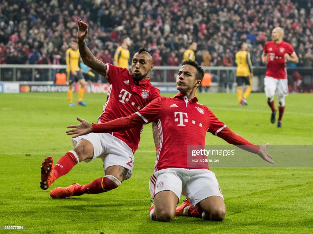 Thiago Alcantara of FC Bayern Muenchen celebrates with team mate Arturo Vidal after scoring his team's fourth goal during the UEFA Champions League Round of 16 first leg match between FC Bayern Muenchen and Arsenal FC at Allianz Arena on February 15, 2017 in Munich, Germany.